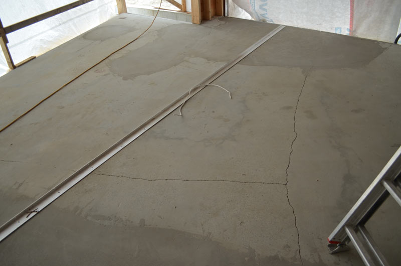 CRACKS-IN-CONCRETE-FLOOR-+-ALUMINUM-ATTACHMENT-ANGLE-FOR-CURTAIN-WALL-WINDOW-FRAMES