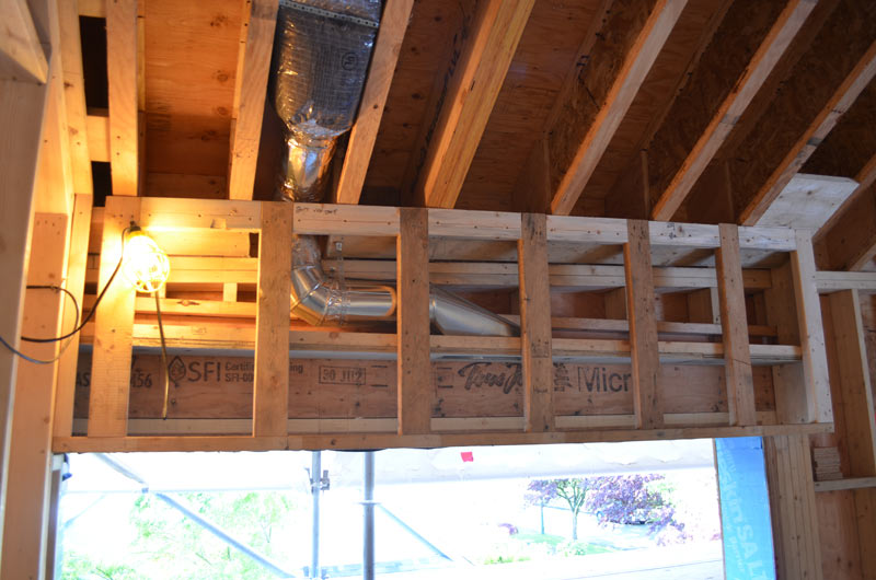 wood framing around concealed air supply pocket over