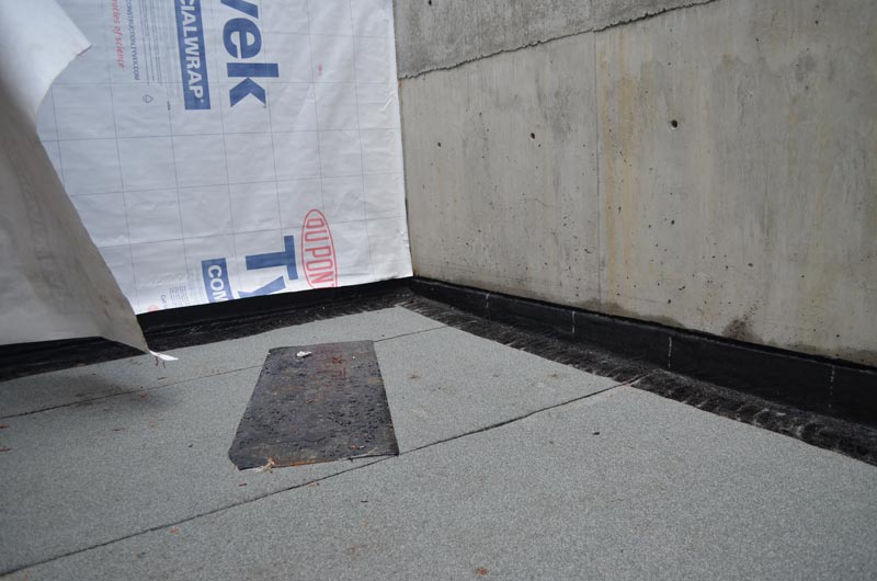 reglet-in-concrete-wall---example-of-patio-waterproofing-tying-into-exposed-concrete-wall-2