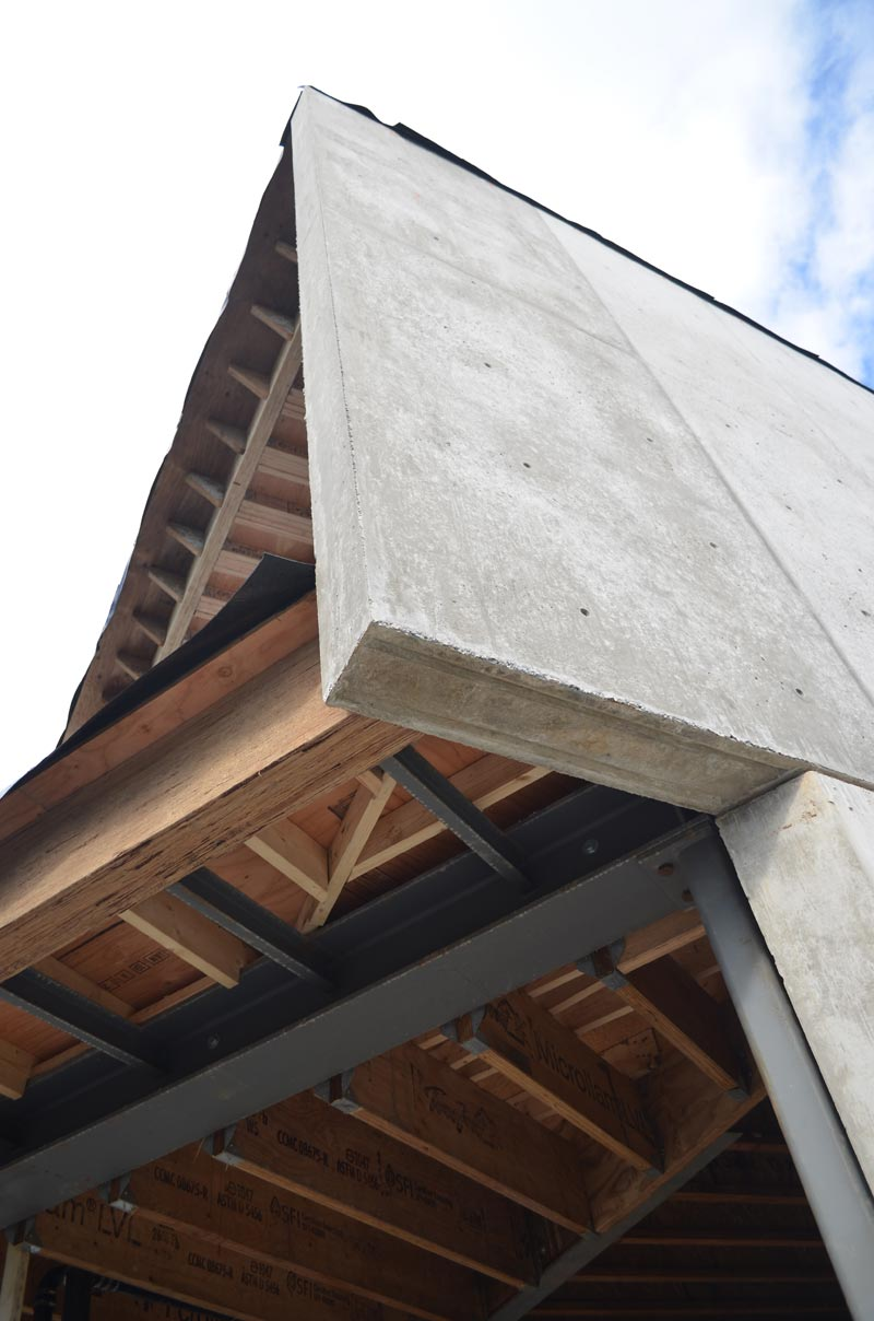 wood-and-steel-framing-at-a-concrete-wall---cantilevered-concrete-fin-wall-at-deck-framing