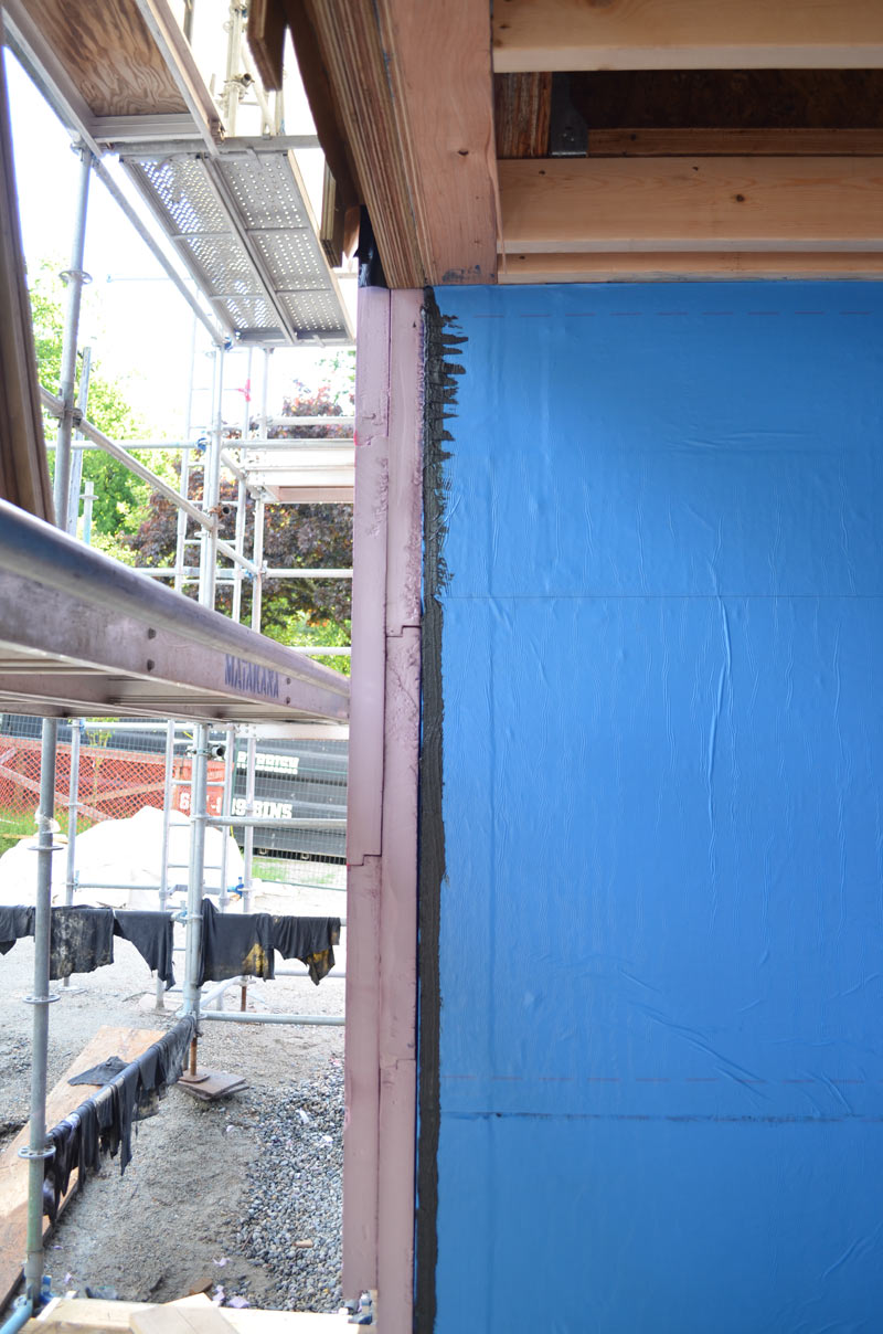 APPLICATION-OF-RIGID-INSULATION-OVER-BLUESKIN