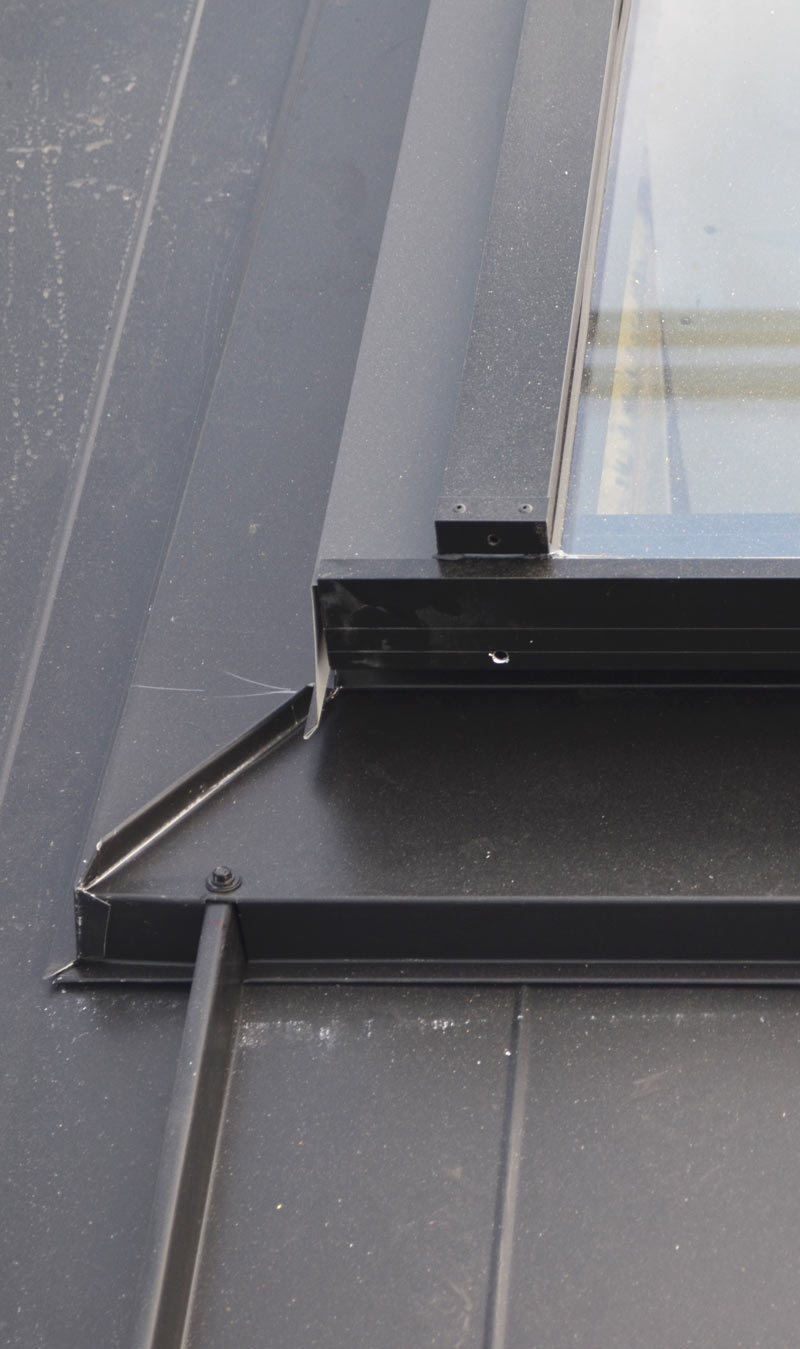 SKYLIGHT-OVER-METAL-STANDING-SEAM-ROOF-CORNER-DETAIL