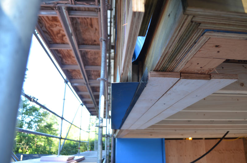 SOFFIT-MOCKUP-AT-EXTERIOR-RIGID-FOAM-INSULATION-APPLICATION