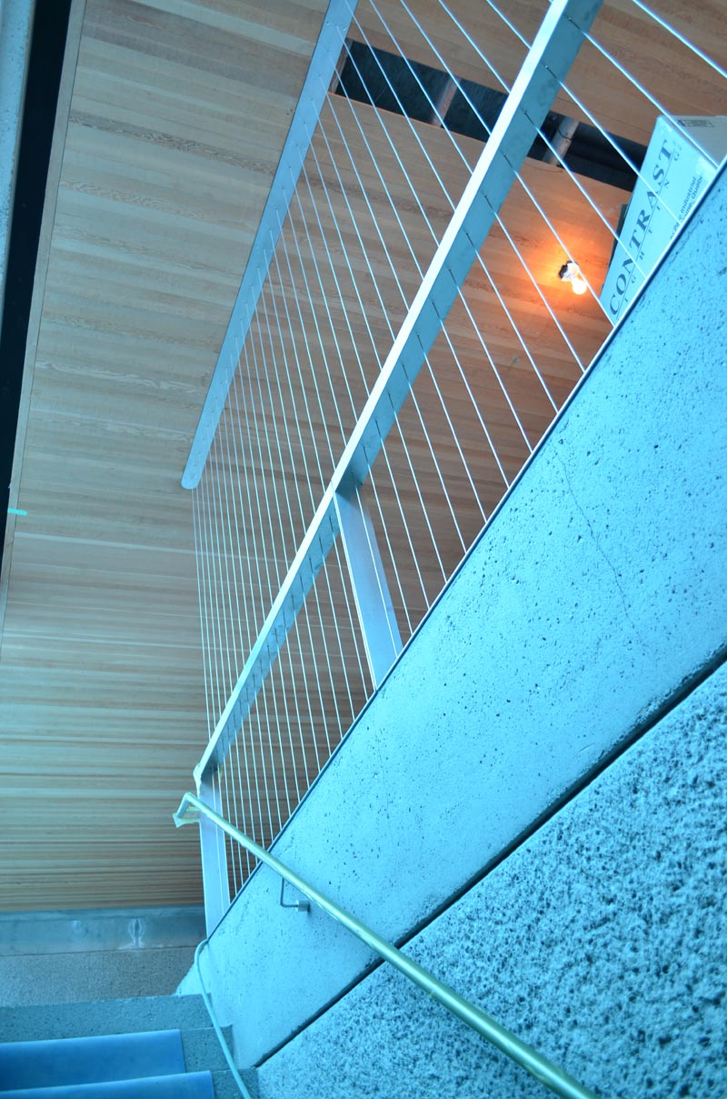 VERTICAL-STEEL-CABLE-SCREEN-DESIGNED-TO-SERVE-AS-A-GUARD-ALONG-STAIR-WELL-OPENING