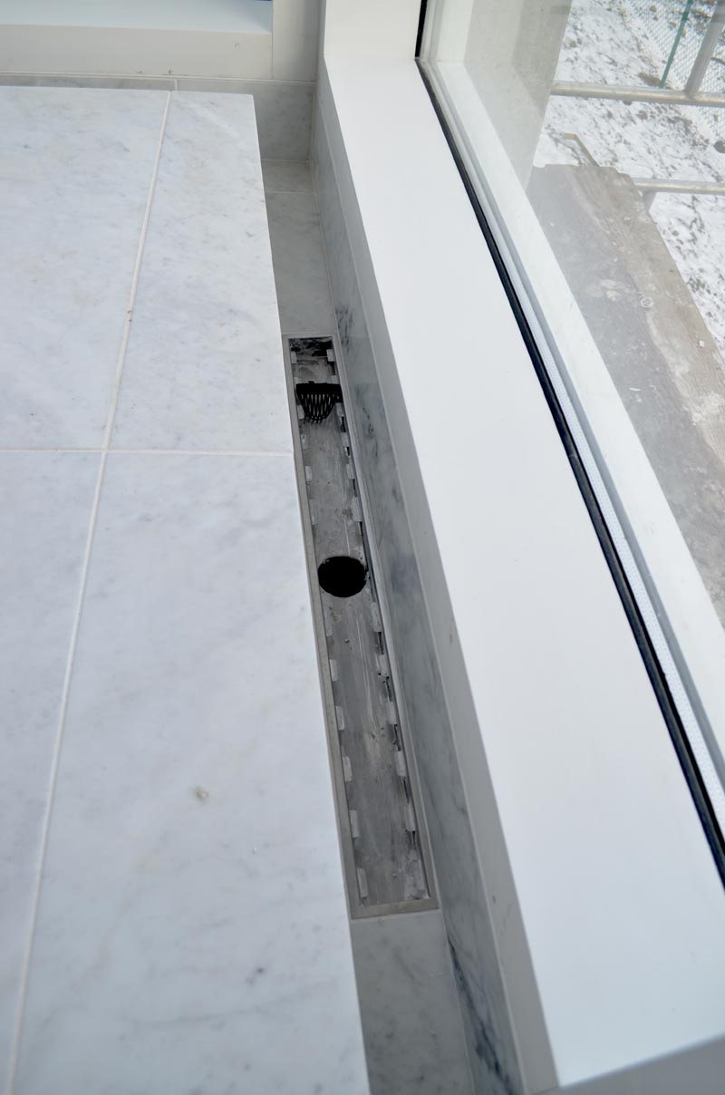 Detail-showing-trench-drain-drainage-in-master-shower