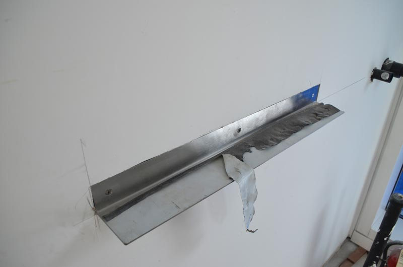 Detail---stainless-steel-shelf-at-shower