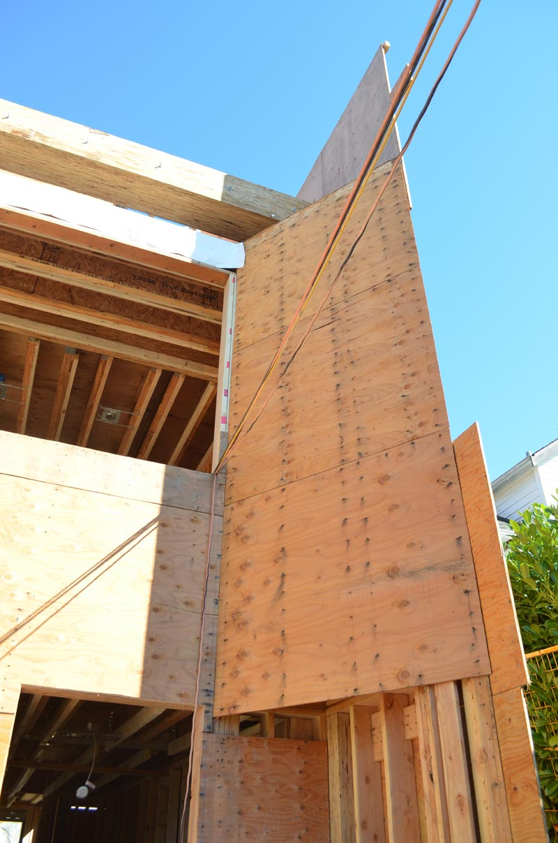 knife-edge-fin-wall-wood-framing-over-triangular-concrete-foundation-wall-3