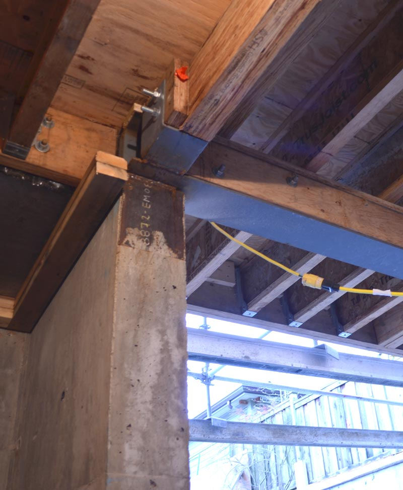 offset-connection-between-steel-I-beam-and-concrete-foundation-wall-2