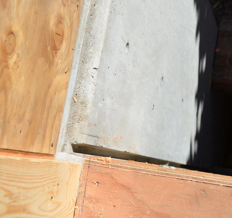 well-executed-half-eanch-reveal-in-concrete-foundation-wall-at-plywood-wall-sheathing